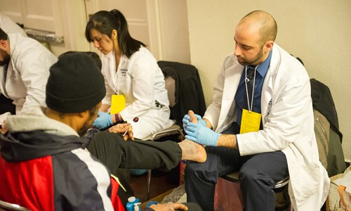 Podiatry residents share care and a compassionate ear at annual Homeless Stand Down